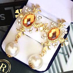 """Шикарні сережки """"Імператриця"""" золотистого кольору."""