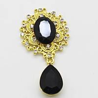 Шикарный камень в золотой оправе камень черный с подвеской. Очень красиво смотрится.