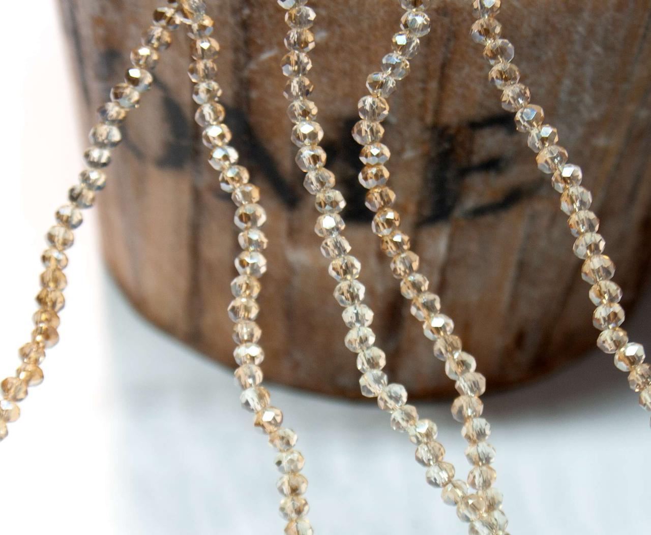 Кришталеві намистини 2х2мм кількість: 180-190 шт, місячний камінь з коричневим бочком
