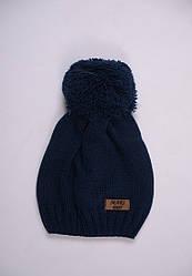 Теплая  вязаная демисезонная шапочка