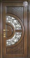 """Входные металлические двери """"ПАТИНА"""" со стеклом и ковкой."""