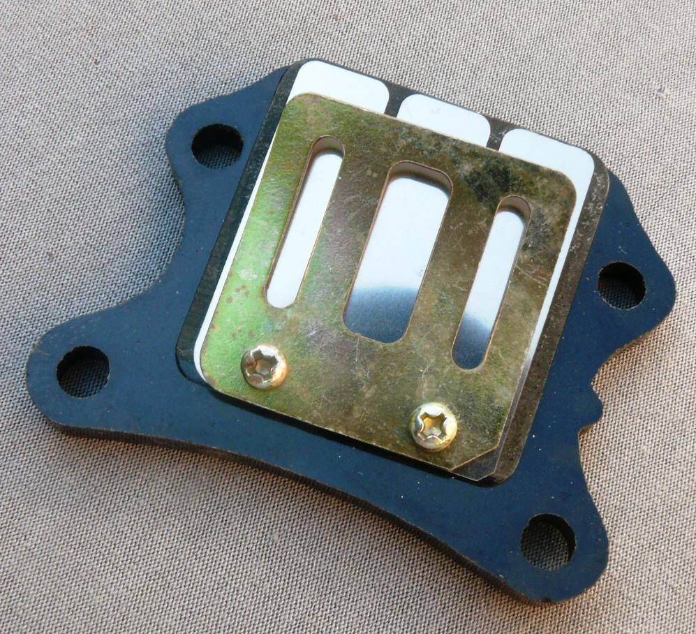 Лепестковий клапан на скутер   Honda TACT