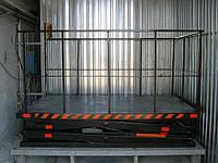 Подъемный стол, гидравлический подъемник грузовой.
