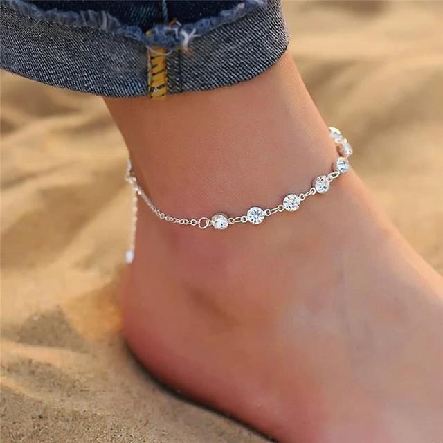 Анклети прикраси на ногу