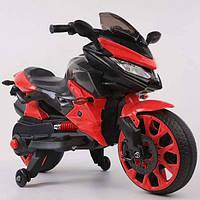 Детский электромотоцикл. Мягкие колеса. 2 двигателя. Индикатор заряда. Скорость 3 км/ч. Красный. T-7233 EVA