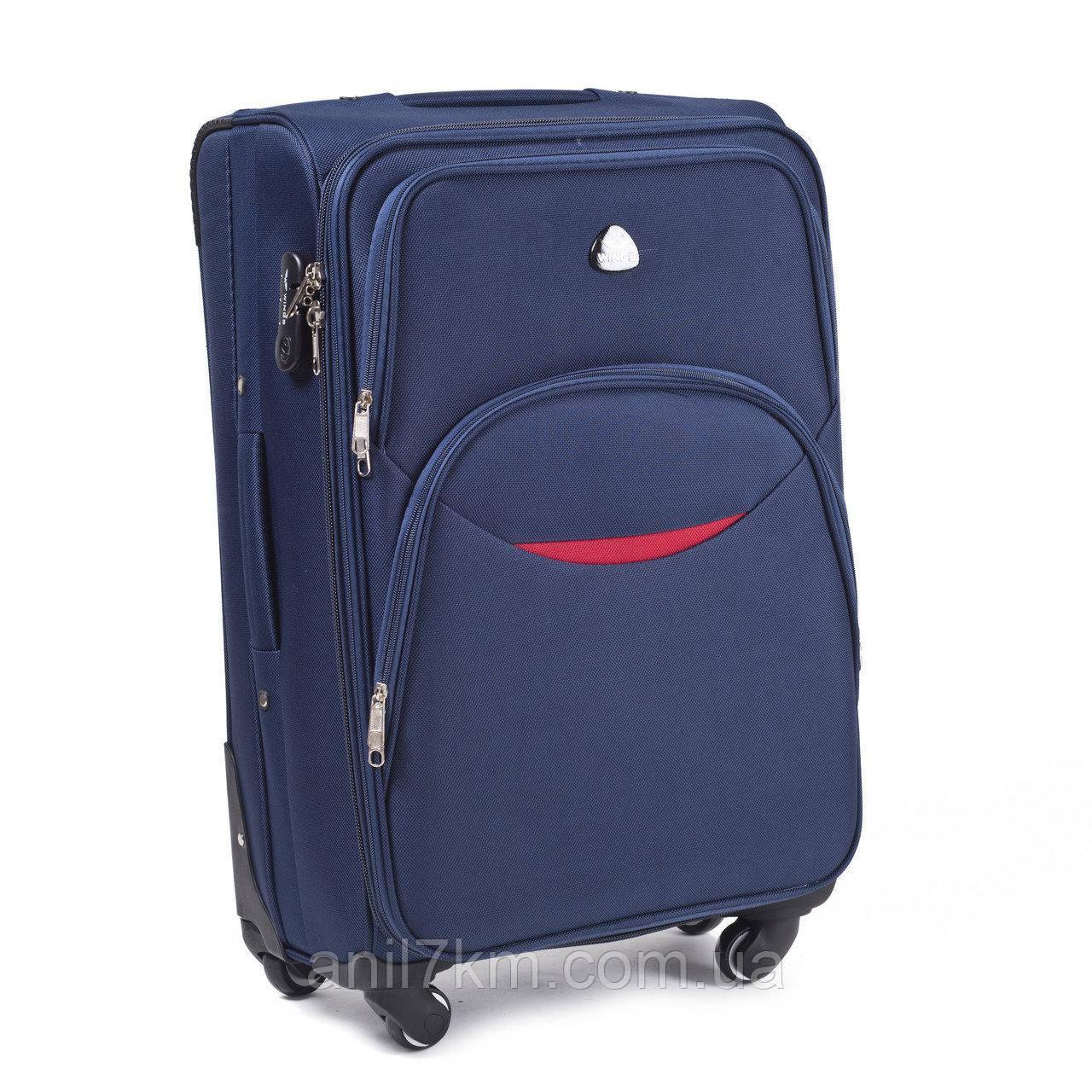 Великий дорожній чемодан на чотирьох колесах