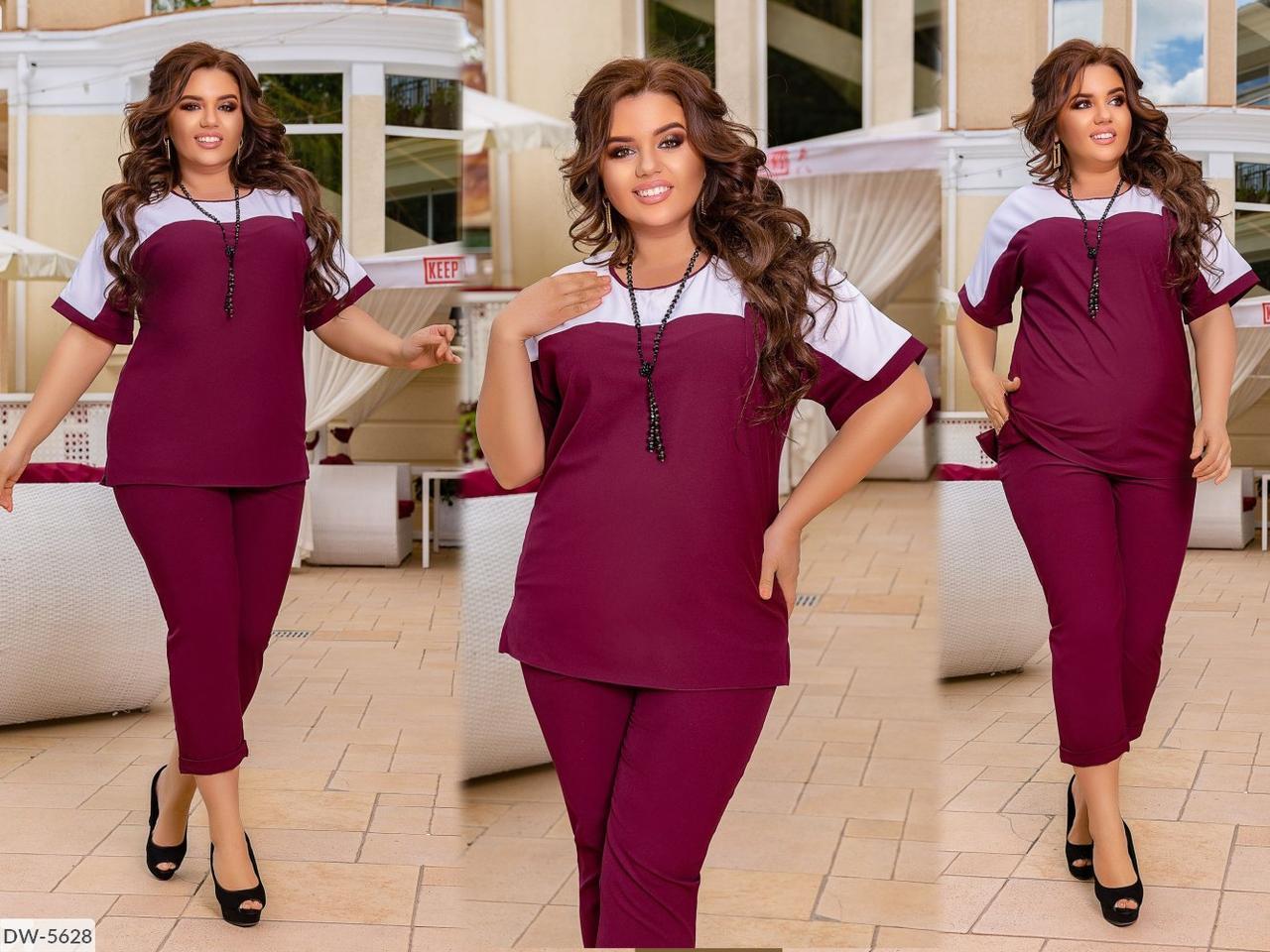 Стильний жіночий комплект, що складається з блузи і штанів 50-52