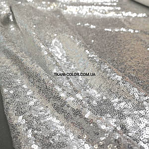 Тканина пайетка дрібна на сітці срібло