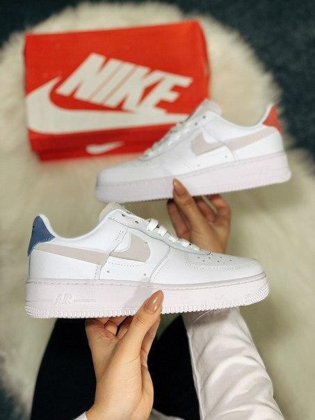 Жіночі білі кросівки Nike з натуральної шкіри