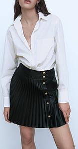 Женская плиссированная юбка из экокожи на кнопках 42-46 р