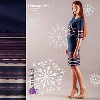 Теплое эффектное платье из плотной костюмной ткани.