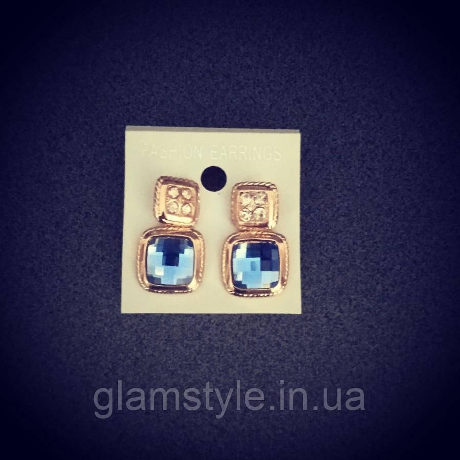 Женские серьги с голубым камнем