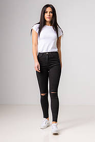 Cеро-черные джинсы-скинни и разрезом на коленях со средней  посадкой в размерах: S, M, L.