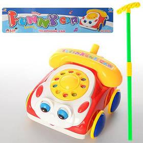 Каталка 0315 (48шт) машинка-телефон, на палиці,звук, двиг.очима, показ. мова,в кульку, 28,5-29-13см