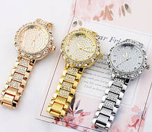 Жіночі наручні годинники з камінням