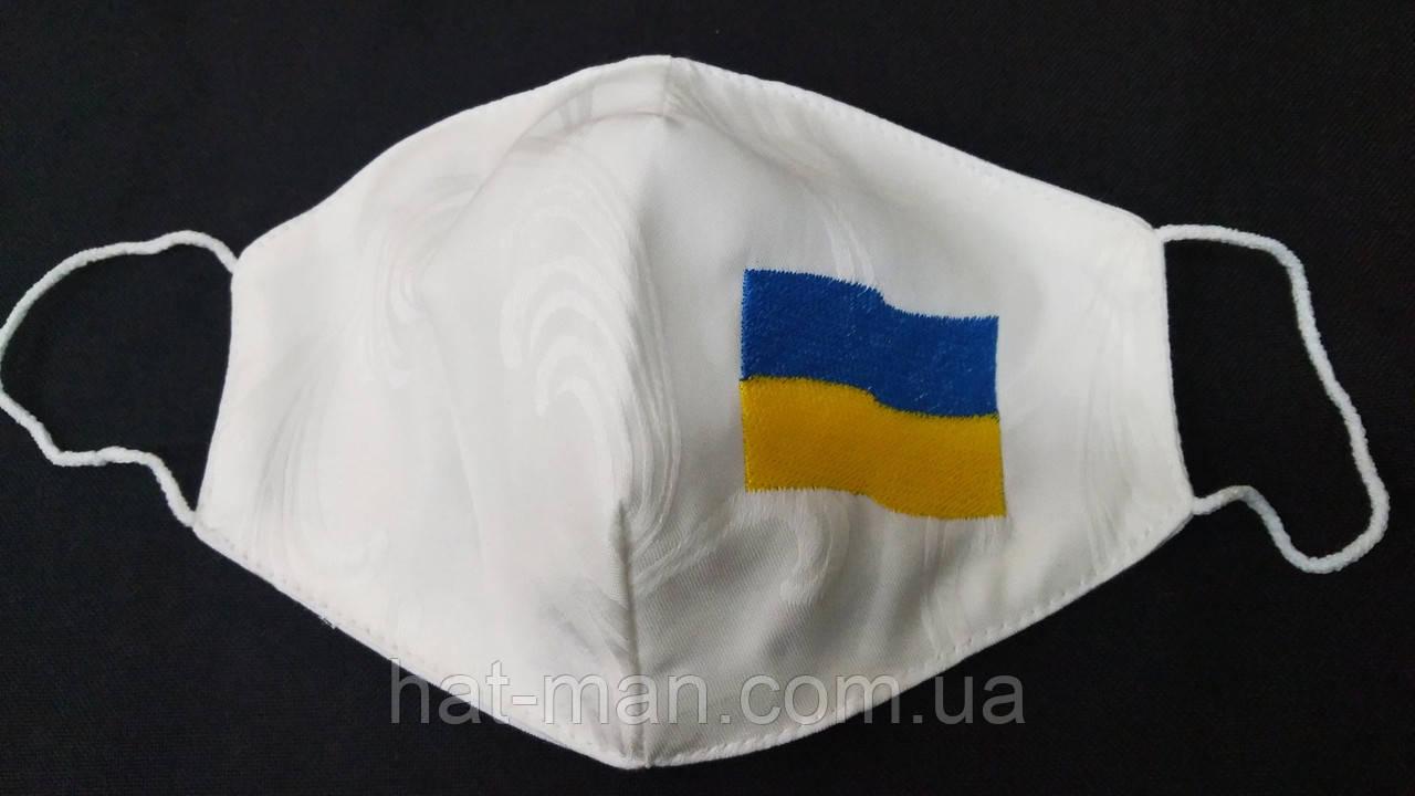 Маска трикотажна біла з вишитим українським прапором