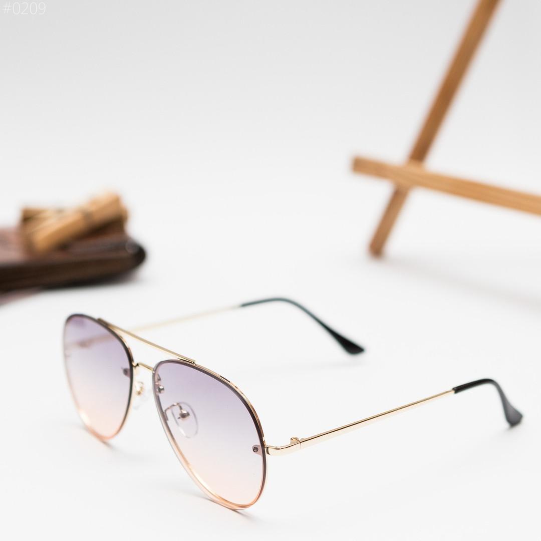 Чоловічі золотисті сонцезахисні окуляри