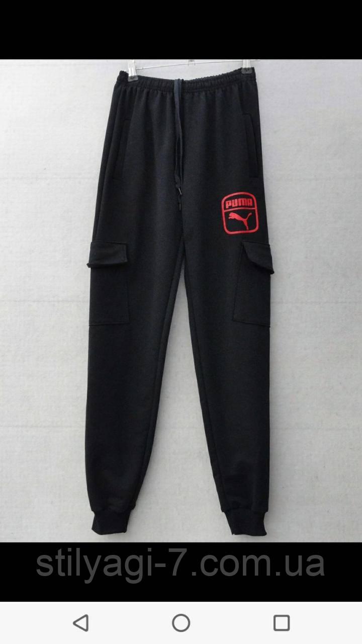 Спортивные штаны для мальчика на 8-12 лет черного цвета с надписью Пума оптом