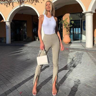 Трендові класичні штани з декоративними розрізами з ефектом кльош