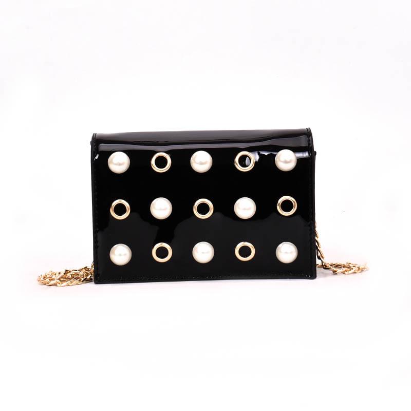 Чорна сумка з перлами