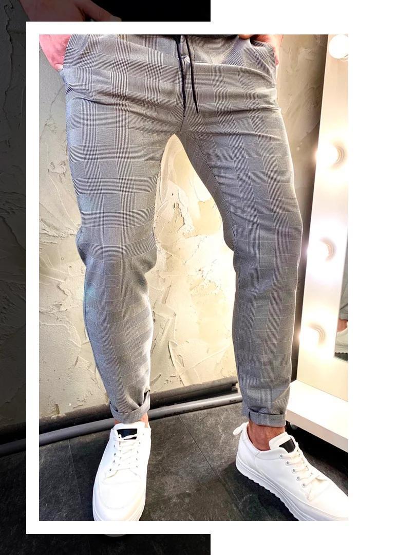 Чоловічі повсякденні стильні сірі штани в клітку