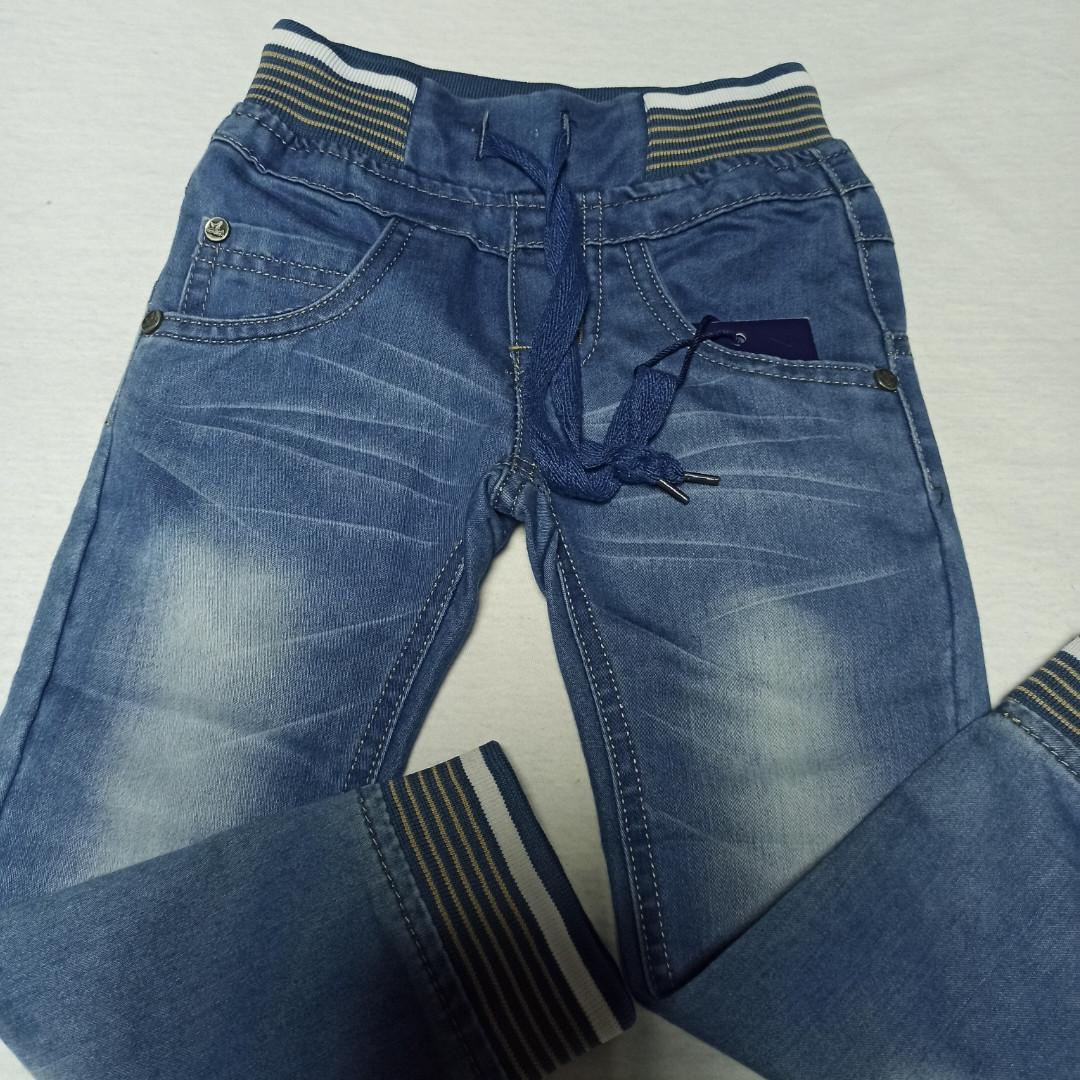 Джинси жіночі демісезонні красиві оригінальні синього кольору для хлопчика. Пояс - шнурівка.