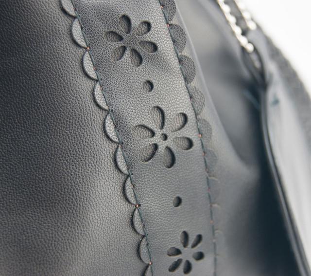 Женская сумка-мешок черная увеличенное изображение.