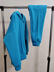Женский спортивный костюм. Цвет голубой. Размер S, M, L, XL