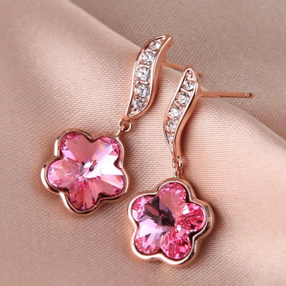 Сережки у вигляді квітки жіночі рожеві кристали Сваровскі позолота