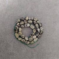 Намистини на нитці Пегматит Єврейський камінь галтовка d-8х10(+-)мм L-38см