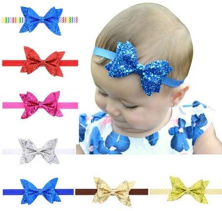 Повязка с бантиком для девочки от 0 до 5 лет синяя блестящая