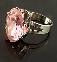 Кольцо под серебро с розовым фианитом. Диаметр кольца: 2 см. Безразмерное с 18р.