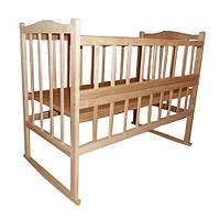 Детская кроватка КФ с фигурной спинкой, откидным боком, качалкой и колесами
