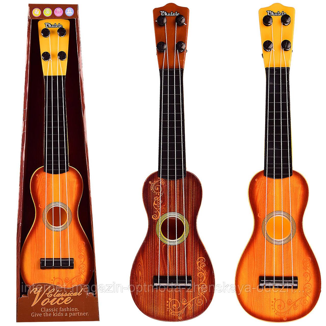 Интересная детская акустическая гитара