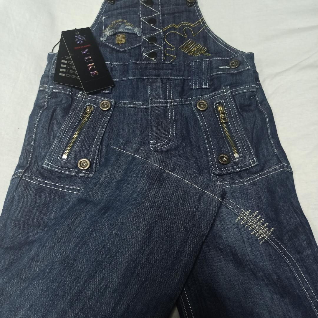 Комбинезон демисезонный джинсовый модный оригинальный красивый синего цвета.
