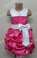 Нарядное детское платье декорированное бусинками и бантом
