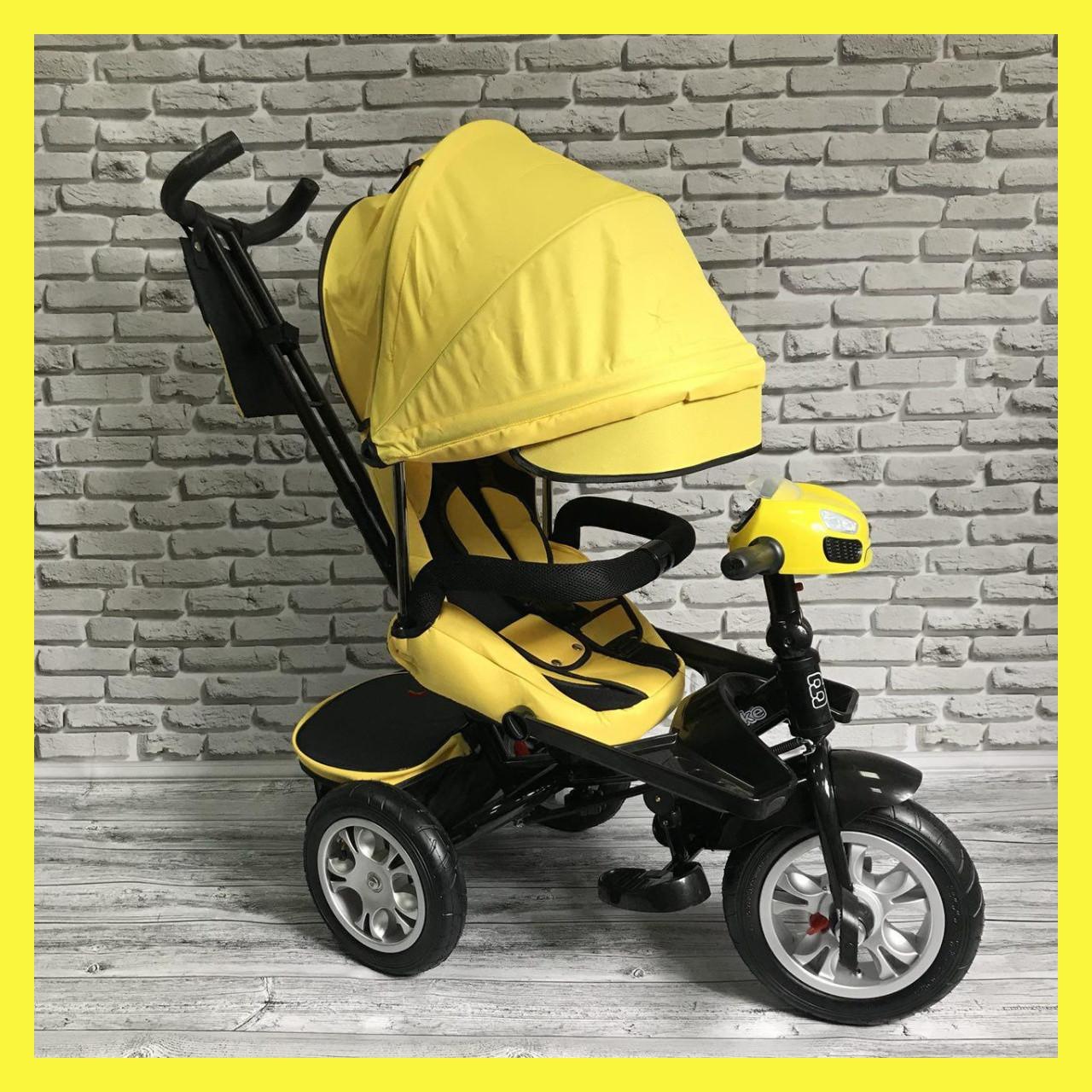 Дитячий триколісний велосипед-коляска з поворотним сидінням батьківською ручкою і дахом 5099-1 ЖОВТИЙ