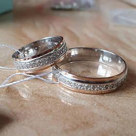 Обручальное кольцо 925 пробы со вставкой золота 375  пробы и камней по всему кругу с покрытием родия