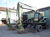 Аренда экскаватора колесного Caterpillar M315