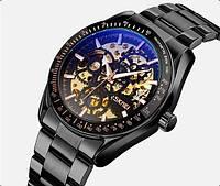 Часы механические скелетоны с автоподзаводом мужские черные с золотистым на браслете Skmei 9194