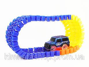 Дитяча світиться іграшкова залізниця Magic Tracks 220 деталей + 2 машинки