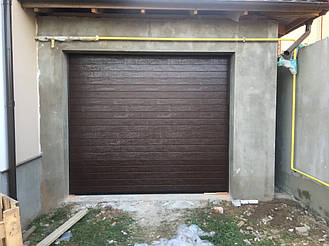 Установлены секционные ворота Doorhan в цвете Ral 8014 размер панели - S