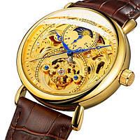 Механические наручные мужские часы золотые с маятником на кожаном ремешке Forsining скелетон
