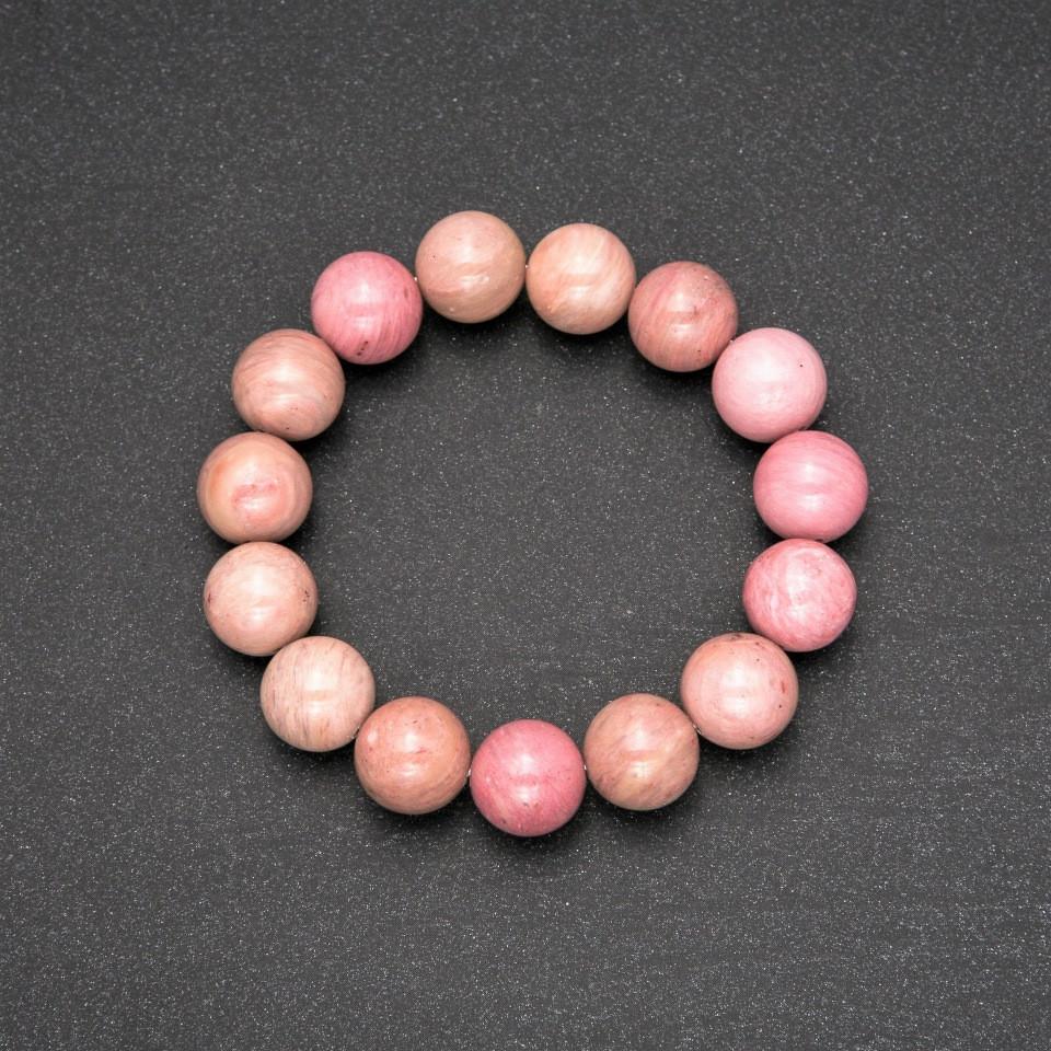 Браслет из натурального камня Родонит гладкий шарик d-12(+-)мм обхват 18см на резинке
