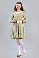 Необычное по крою детское платье из костюмной ткани
