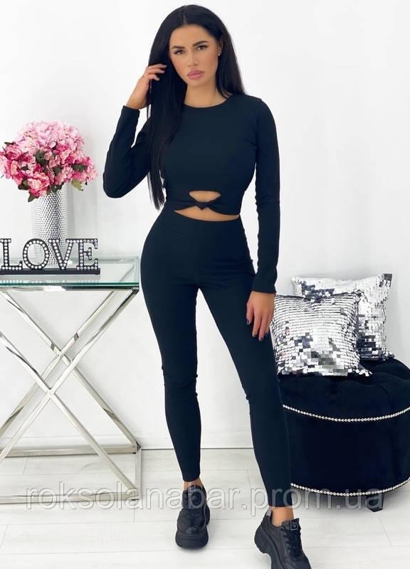 Трикотажний жіночий спортивний костюм чорного кольору