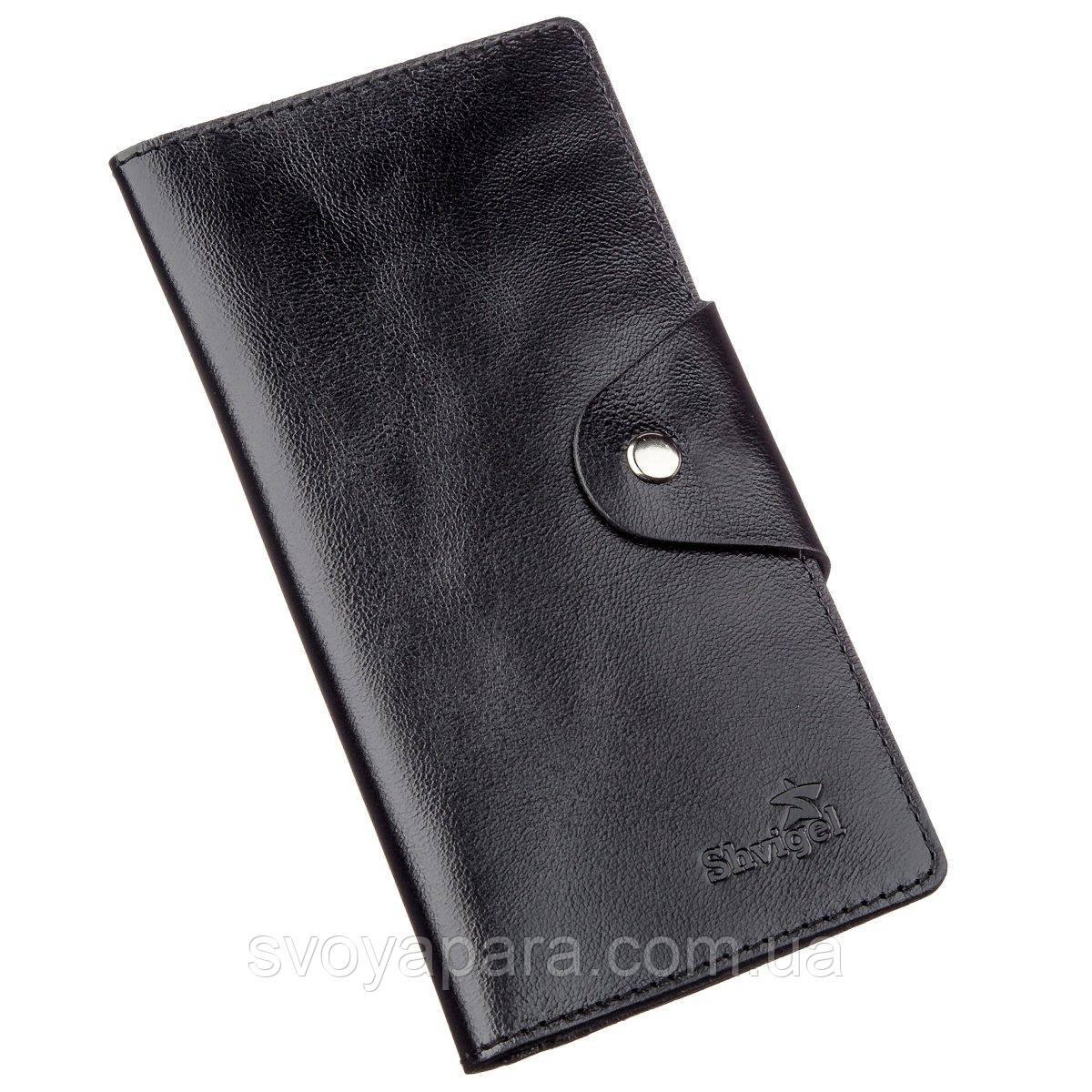 Гаманець чоловічий вертикальний зі шкіри алькор на кнопках SHVIGEL 16177 Чорний