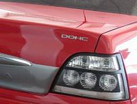 Надпись DОНС крышки багажника Нексия GM Корея (ориг) 96232141