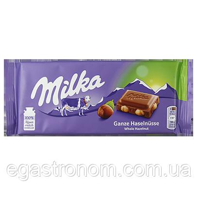 Шоколад Мілка цілий лісовий горіх Milka whole hazelnut 100g 17шт/ящ (Код : 00-00005501)