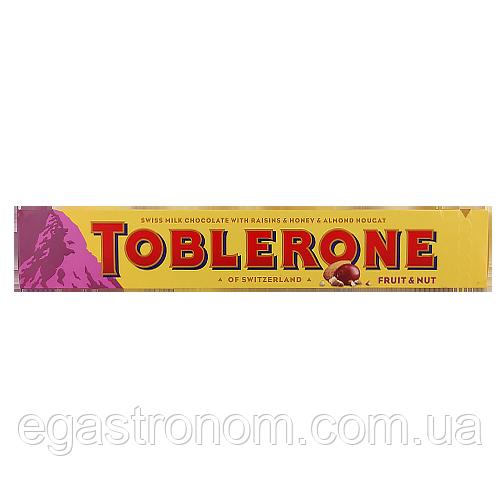 Шоколад Тоблероне молочний з фруктами та горіхами (фіол.) Toblerone 100g 20шт/ящ (Код : 00-00003485)